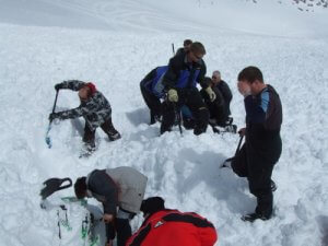 Difficult to dig snowmobile out of avalanche