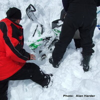 Snowmobile dug out of avalanche debris