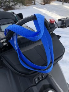 Webbing strap to pull on ski of a stuck sled